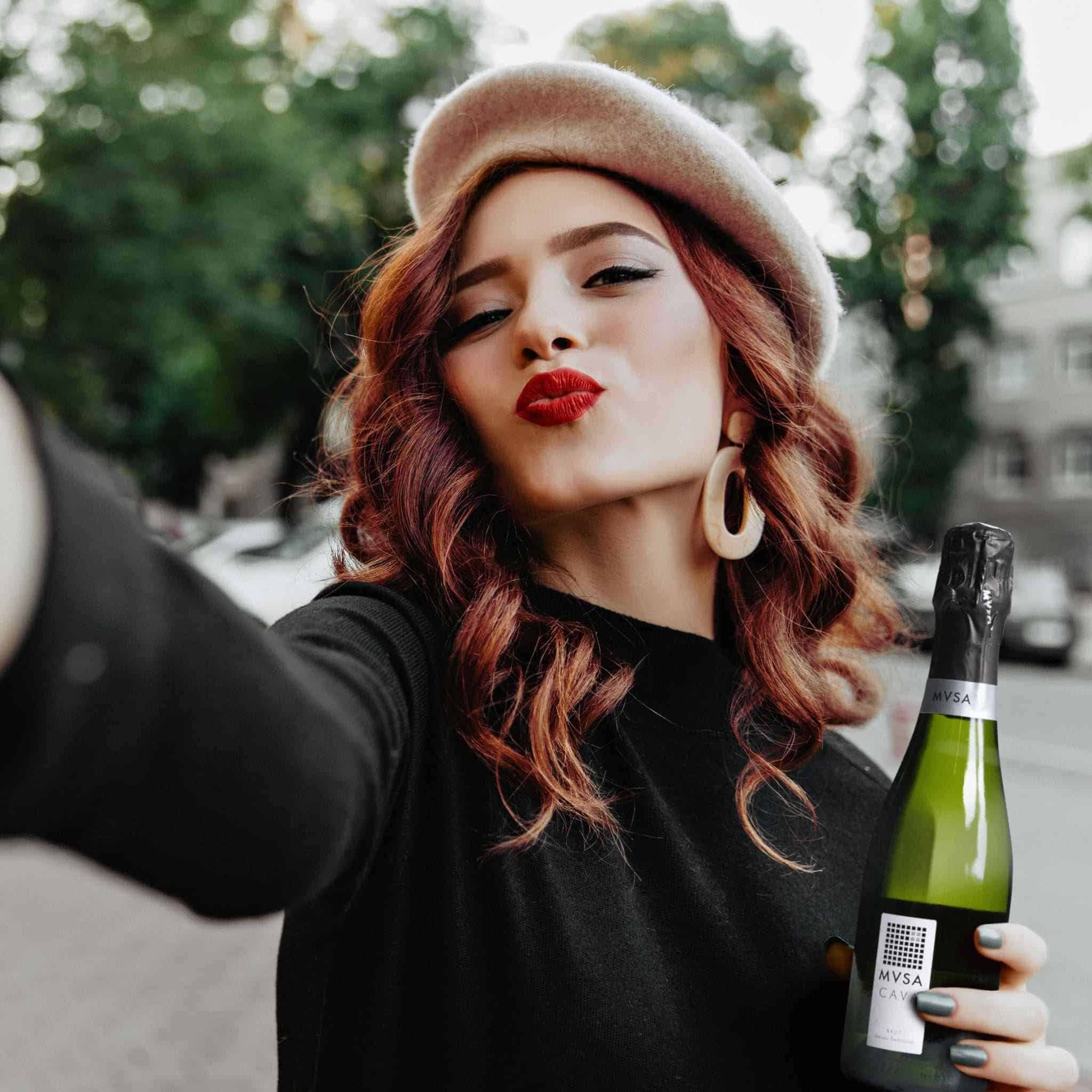 Photo of a girl and a bottle of MVSA Cava by Supermoon